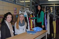 Shauni Sorge, Kelsi Wikston and Amanda Volpatti setup the donated formal dresses on sale to help fundraise for this years Prom.